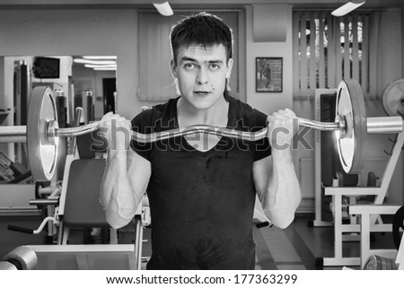 Sporty man doing exercises in gym