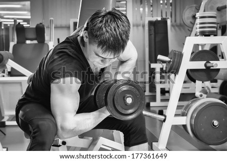 Sporty man in gym - stock photo