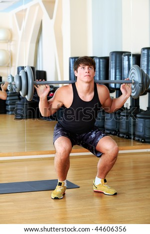 Sporty man in the gym centre. - stock photo