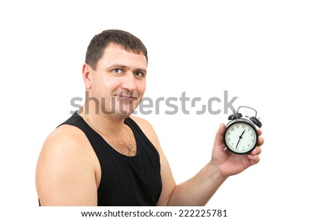 sporty man with a clock in his hand - stock photo