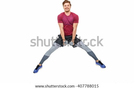 Sporty man with dumbbells isolated on a white backgorund. - stock photo