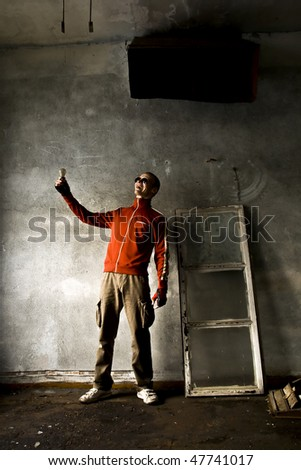 sporty man with lamp - stock photo