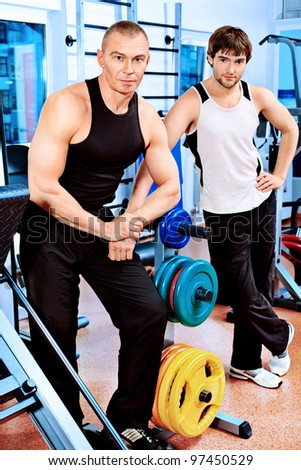 Sporty men in the gym.