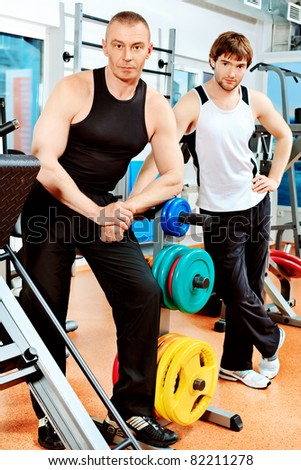 Sporty men in the gym centre.