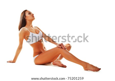 Sporty sexy  woman siting on the floor on white background - stock photo