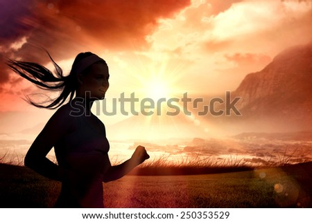 Sporty smiling blonde jogging against sunrise over magical sea - stock photo