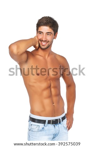 Sporty smiling man with a naked torso and beautiful muscles. Isolated on a white background - stock photo