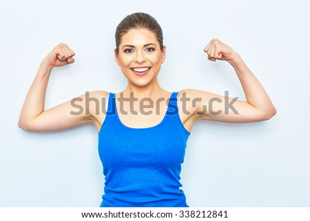 sporty smiling woman show power in muscle. funny concept of healthy life. white background. - stock photo
