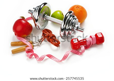 Sporty still life / photo of weight training and fitness equipment on white background   - stock photo