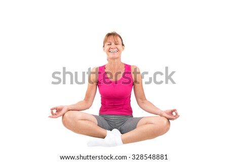 Sporty woman meditating and laughing - stock photo