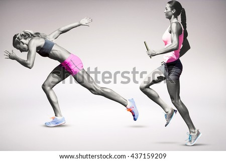 Sporty woman running on a grey background - stock photo