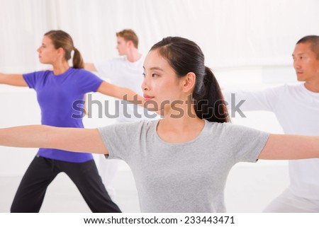 Sporty woman stretching her hands yoga class in fitness studio