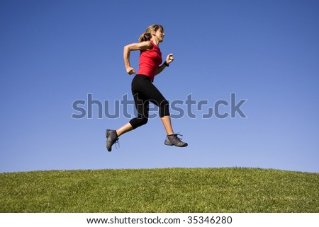 Sporty women running on the park - stock photo