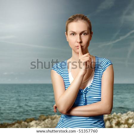 Sporty women with finger near mouth - stock photo