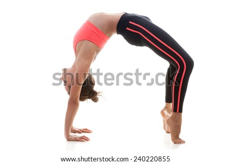 Sporty yoga girl on white background performing Chakrasana (Urdva Dhanurasana Wheel Pose or Upward-Facing Bow Pose)
