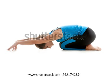 Sporty yoga girl on white background relaxing - stock photo