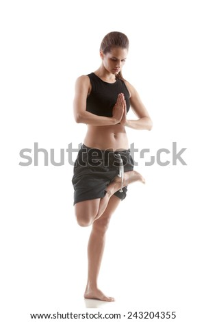 Sporty yoga girl on white background with palms in Namaste gesture