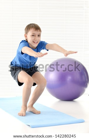 sporty young guy in blue doing exercises