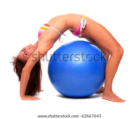 Sporty young woman with blue ball. - stock photo