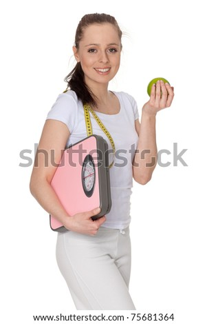 Sporty young woman with scales and apple on a white background.  Concept of healthy lifestyle.
