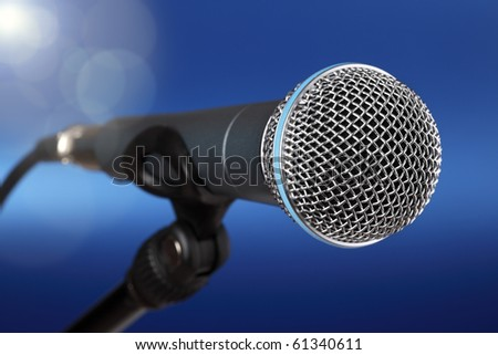 Spot light on a microphone on stage - stock photo