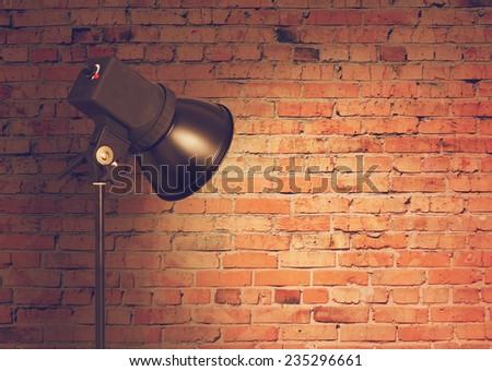 spot light on brick wall, retro film filtered, instagram style  - stock photo