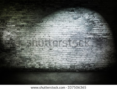 Spot light on old white brick wall - stock photo