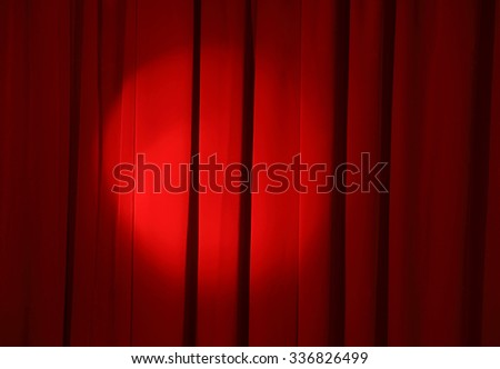 spot light on the red curtain of stage - stock photo