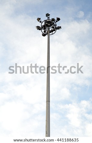 Spot-light tower at the road on blue sky background - stock photo