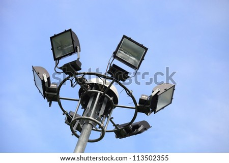 Spot-light tower in blue sky - stock photo