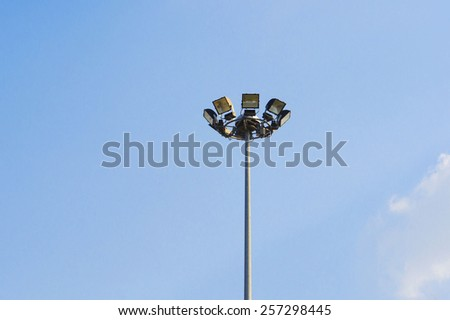 Spot light tower on blue sky background - stock photo