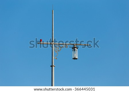 Spot light tower on the beach with blue sky background in Phuket