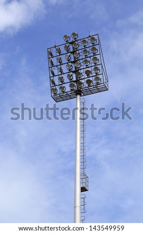 Spot-light tower with blue sky - stock photo