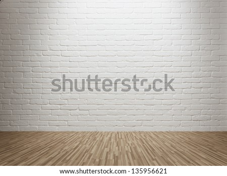 Spot lit empty room with white brick wall and copy space - stock photo