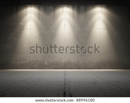 Spotlight illuminate grungy concrete - stock photo