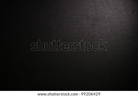 Spotlight on black background - stock photo