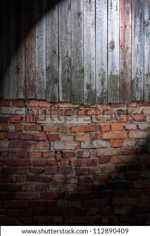 Spotlight on Dark Grungy Wall - stock photo
