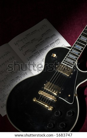 Spotlight on detail of rock guitar - stock photo