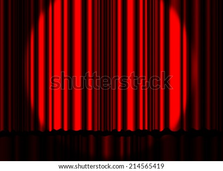 Spotlight on red stage curtain.