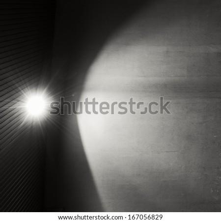 Spotlight on the concrete wall - stock photo