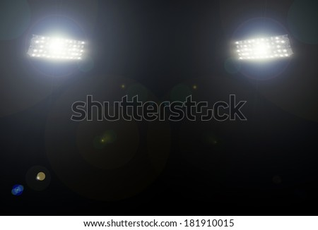 spotlight over the stadium - stock photo