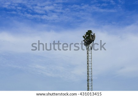 Spotlight pole on blue sky background