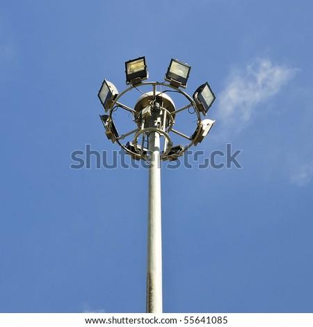 spotlight with blue sky background - stock photo