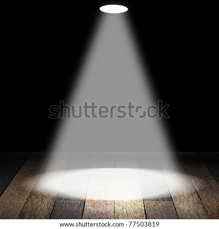 Spotlights on wooden floor in empty room - stock photo
