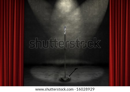 Spotlights shining on a stage with microphone, framed with red curtains
