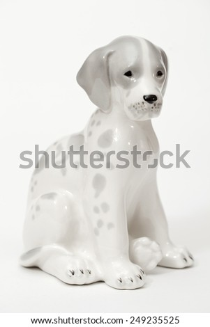 Spotted Dalmatians. Ceramic figurine, dog breed isolated on white - stock photo