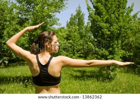 Spoty girl making yoga outdoors