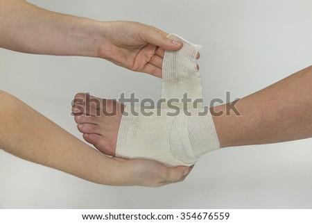 sprained ankle bandage - stock photo