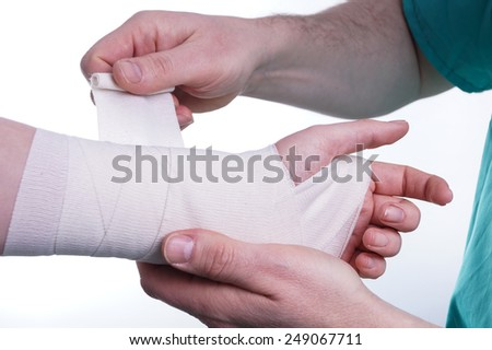 Sprained hand, Doctor helping with the Bandage