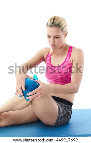 Sprained knee need ice placed on the injury as soon as possible. - stock photo